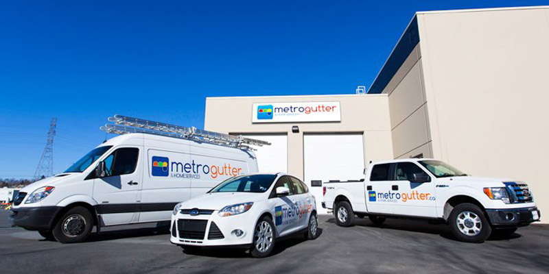 Metro Gutter and Home Services vehicles
